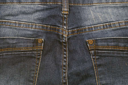 Black jeans fabric (denim). View of the back of the pants.