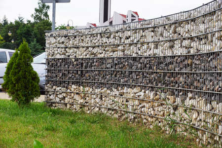 Separation of the street from the park area. A fragment of space arrangement with the use of gabions.