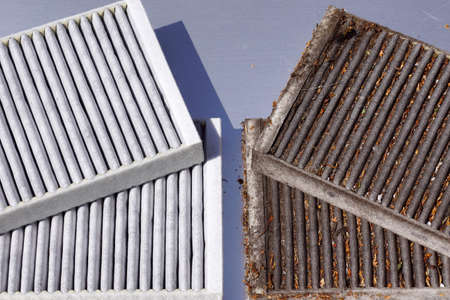 Clean filter and used filter to be replaced. Comparison of two car cabin filters.
