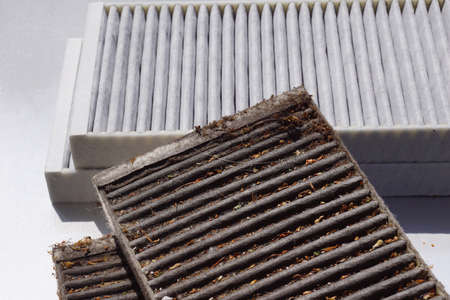 Comparison of two car cabin filters. Clean filter and used filter to be replaced.