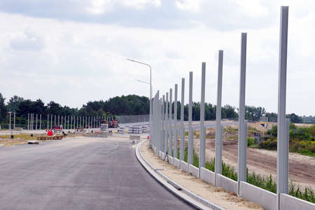 Construction of the highway. Installation of structures for sound-absorbing panels to protect residents from noise.