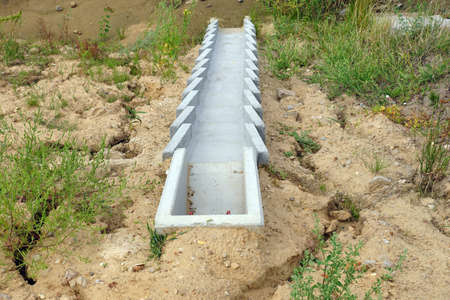 Construction of the highway. A system of concrete modules for draining excess water from the road surface.