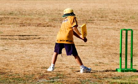 Visual moments from childrens cricket games  Stock Photo