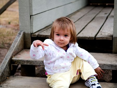 carers: A young girl playing in a public park  Stock Photo