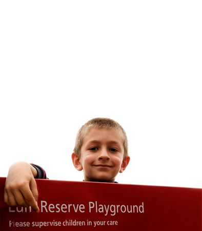 carers: A young boy playing in a public park