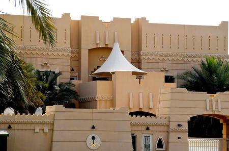 Art photos about a peaceful country, its architecture, desert, dunes, sundowns, camels and belly dancing