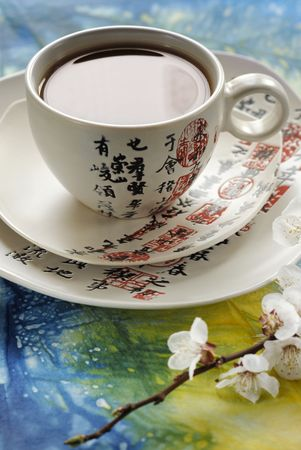 flowerses: Tea in the cup with hieroglyphic Stock Photo