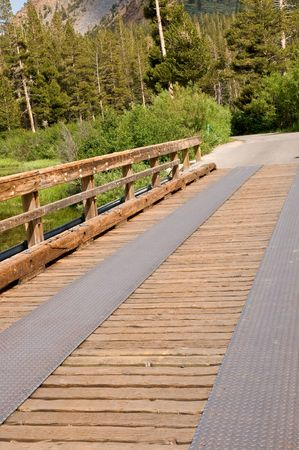 Rustic wooden bridge at a mountain lake - Mammoth lakes, California Stock Photo - 3339260