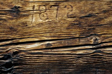 Grunge rustic wooded cabin wall - closeup background with year 1872 marking