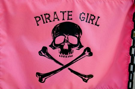 Pirate girl on pink silk background photo