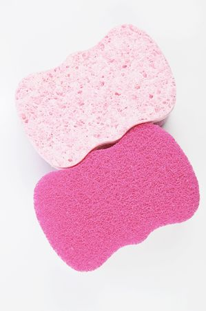 absorbent: Colorful absorbent scrub sponge - closeup isolated on white Stock Photo
