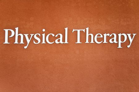 Phisical Therapy - sing on stucco wall Stockfoto