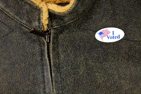 voted: leather-like jacket with I Voted sticker - closeup details