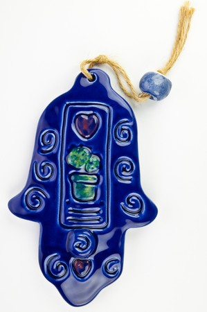 Hamsa hand amulet, used to ward off the evil eye - ceramic wall decoration Stock Photo - 4528821