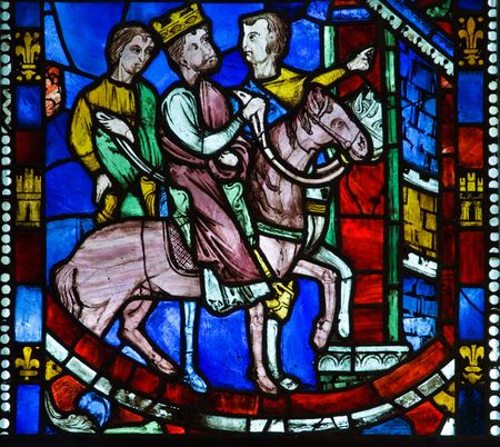 Religious medieval stained glass window in cloister New York - details photo