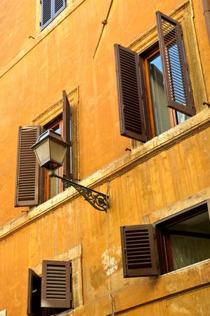 jalousie: Old grunge building, details of facade - Rome, Italy Stock Photo