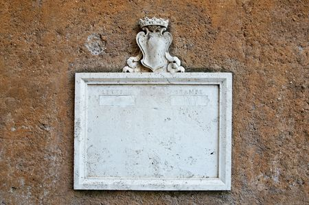 Vintage marble mailbox on stucco wall on Capitoline hill in Rome, Italy photo