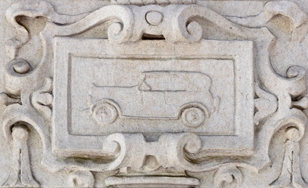 wall textures: Details of carved wall decoration with classic car