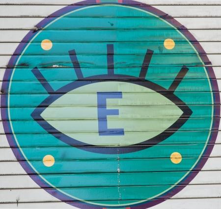 Warning eye sign on grunge metal garage door Stock Photo - 15889307