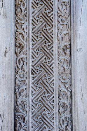 Old weathered wooden wall decoration with carved ornament Banco de Imagens