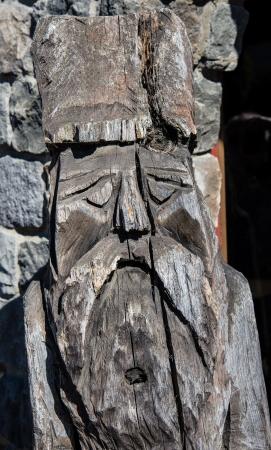 Old rustic wood carved sculture photo
