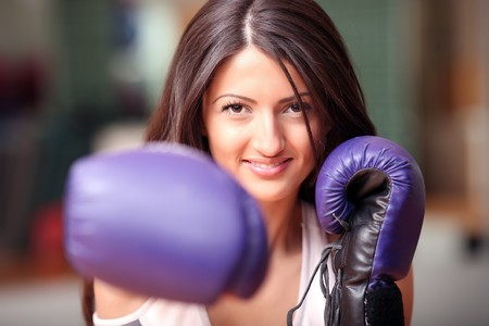 The beautiful girl in boxing gloves. Look other photos of this series: