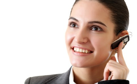 Portrait of young girl with the opened smile, pinning against an ear hands-free device, with optimism looking forward. Look other photos of this series: Stock Photo - 4205337