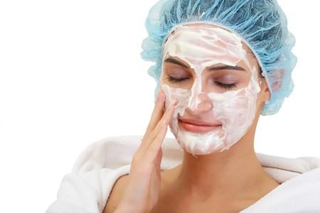 A girl enjoys cream facial in SPA center. Look other photos of this series: Stock Photo - 4205348