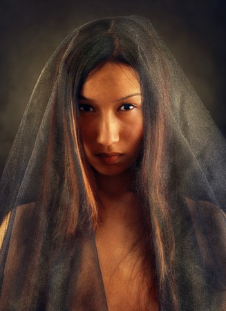 East woman peeking out from behind veil. Look other photos of this series: