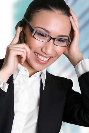 Businesswoman talks by a mobile phone. Please see some of my other business images: Stock Photo - 4331249