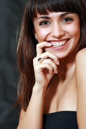 Portrait of the happy lady with the big ring with a jewel on a finger photo