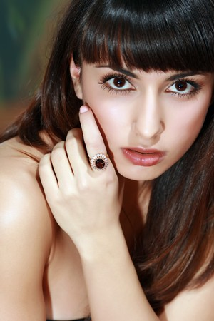 Portrait of the lady with the big ring with a jewel on a finger photo