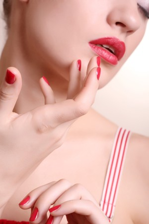 Face of the beautiful girl with maik-up close up, sharpness on fingers, soft focus Stock Photo - 4467701