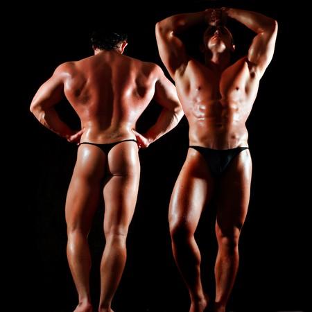 Braungebrannte Bodybuilder mit dem Bared Torso zeigt Muskeln Lizenzfreie Bilder