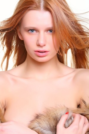 Portrait of the beautiful woman with red hair. photo
