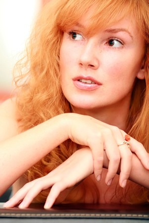 Portrait of the beautiful red-haired girl  photo