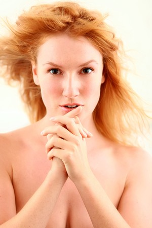 Portrait of the beautiful red-haired girl looking in an objective photo