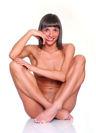 femme se deshabille: Belle jeune fille nue se trouve avoir press� � lui-m�me d'un pied Banque d'images