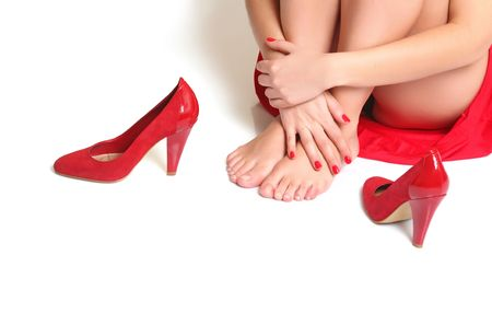 Girl in a red dress sits on a floor, in the foreground of steam of red shoes Stock Photo - 4592341