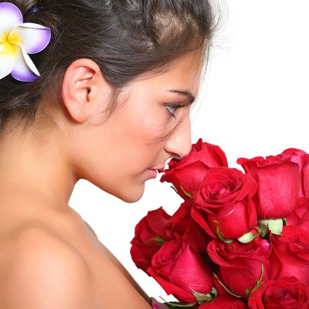 Portrait of the beautiful girl with a bouquet of scarlet roses. photo