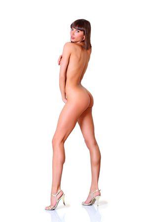 ni�a desnuda: Hermosa chica desnuda en un perfil en los talones Foto de archivo