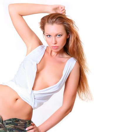 Beautiful girl with magnificent light hair in a white blouse and army shorts Stock Photo - 4592332