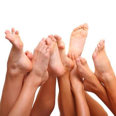 Beautiful female slim feet of group of girls photo