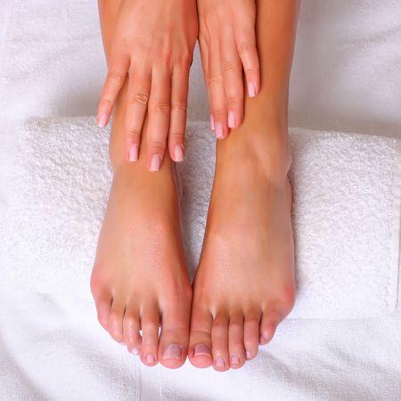 Well-groomed feet of female feet on a white towel