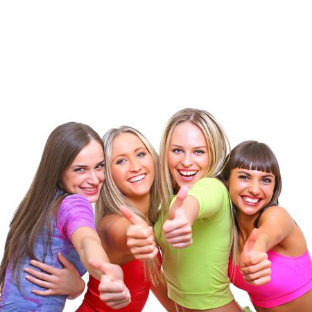 Four beautiful young happy girls in bright multi-coloured clothes Standard-Bild