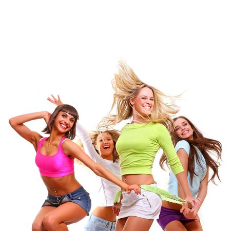 Four beautiful happy young women with a smile in bright multi-coloured clothes, isolated on a white background photo
