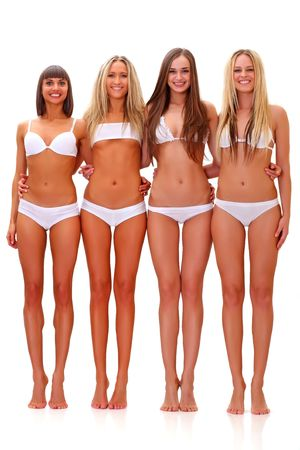 Three harmonous suntanned young women in full growth, in white underwear, isolated on a white background, please see some of my other parts of a body images: