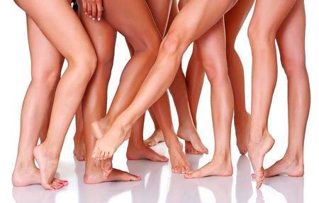 Beautiful graceful female feet, isolated on a white background, please see some of my other parts of a body images photo