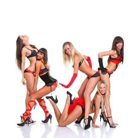 Five beautiful girls in full growth pose in front of the chamber Stock Photo