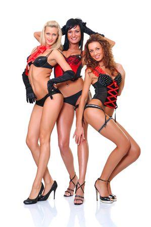 Drei wundersch�ne Frauen in vollem Wachstum stellen sich vor der Kammer Lizenzfreie Bilder